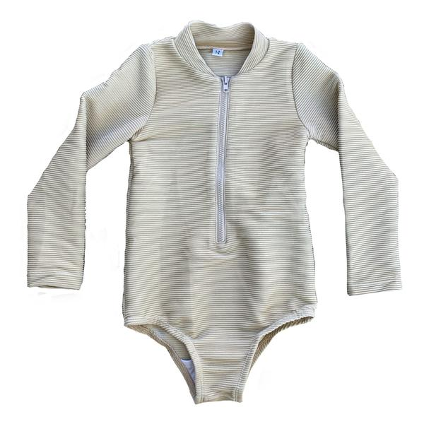 US stockist of RuffetsCo's Maggie slim fit ribbed fawn long sleeve rashsuit.  Made with UPF 50 + fabric, fully lined with front zipper.