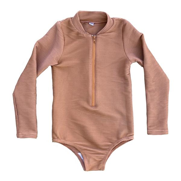 US stockist of RuffetsCo's Maggie slim fit ribbed clay long sleeve rashsuit.  Made with UPF 50 + fabric, fully lined with front zipper.