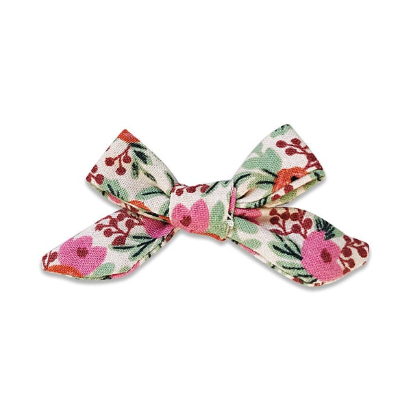 US stockist of Josie Joan's Marni petite bow hair clip.  Cream colored fabric with pink and orange flowers and contrasting green foilage.