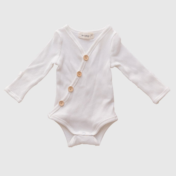 US stockist of Two Darlings gender neutral Milk stretch rib cotton bodysuit. Long Sleeves with 4 non functional wooden buttons kimono style across the front.