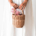 US stockist of Olli Ella handmade small rattan bag with bamboo handles.