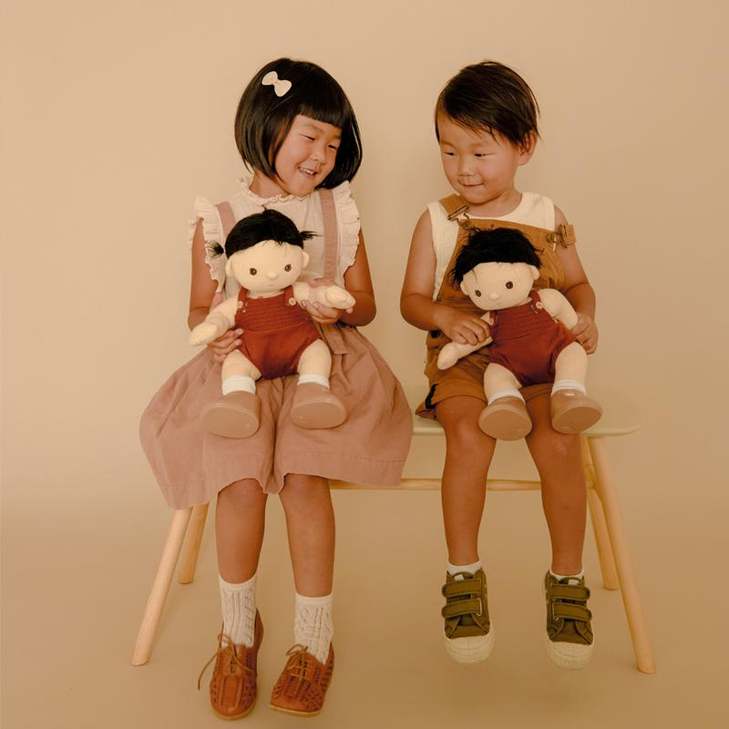US stockist of gender neutral, black haired, brown eyed Olli Ella Roo dinkum doll.