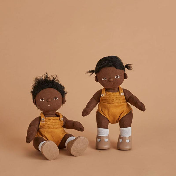 US stockist of gender neutral, black haired, dark eyed Olli Ella Tiny dinkum doll.
