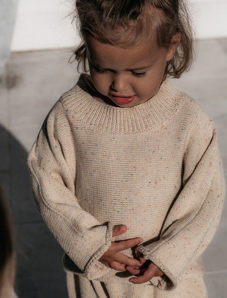US stockist of Fable & Ford's Mini mid weight cotton knit sweater.  In a gender neutral oat color fabric with rainbow sprinkles.  Has a relaxed fit.