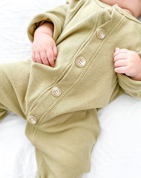 US stockist of Fable & Ford's gender neutral waffle button up romper in olive.  Made from 100% cotton with buttons down the front and thick cuffs.