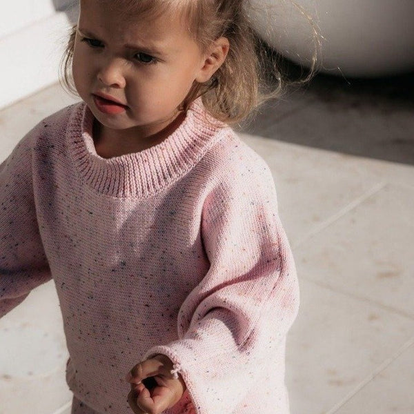 US stockist of Fable & Ford's Mini mid weight cotton knit sweater.  In a light pink color fabric with rainbow sprinkles.  Has a relaxed fit.