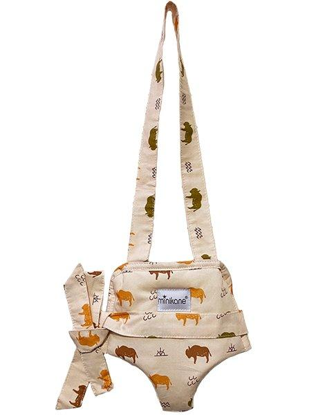 "US stockist of Minikane's buffalo print doll carrier.  Made from an exclusive Minikane fabric in soft cotton.  Fits 13"" dolls and is made in France."