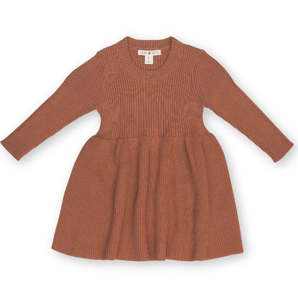 US stockist of Grown Clothing's organic cotton ribbed dress in Terracotta Rose.  Features all over rib knit, long sleeves and fun skirt.