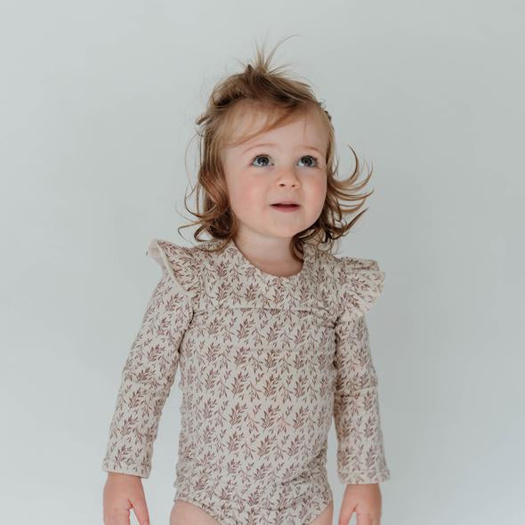 US stockist of Buck & Baa's long sleeve frill rosemary bodysuit.  Made from organic cotton with snaps at crotch for easy diaper changes.