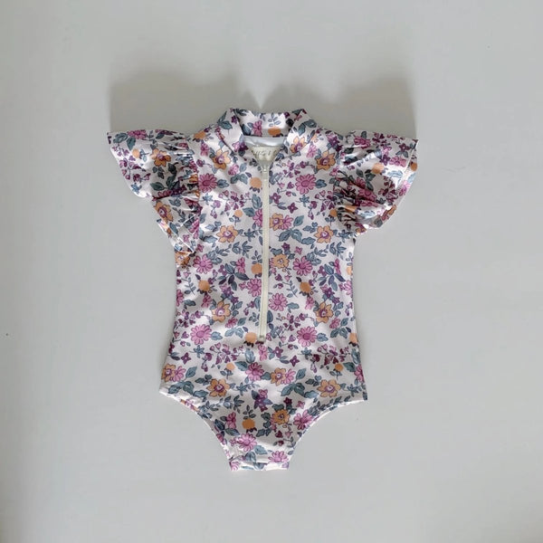 US stockist of Ruffets & Co Mia Short Sleeve Floral Rashsuit with flutter sleeves.