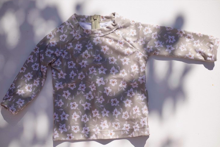 US stockist of Sukoo the Label's long sleeve Belle Rash Top. Made from UPF 50 + Repreve fabric with an all over floral print and invisible zip at back.  Pairs with frill bottoms, sold seperately.
