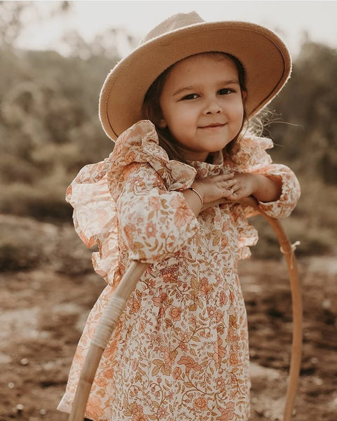US stockist of Bonnie & Harlo's long sleeve floral dress in hues of pink and peach.  Fully lined, with hidden zip at the back and ruffle detailing.