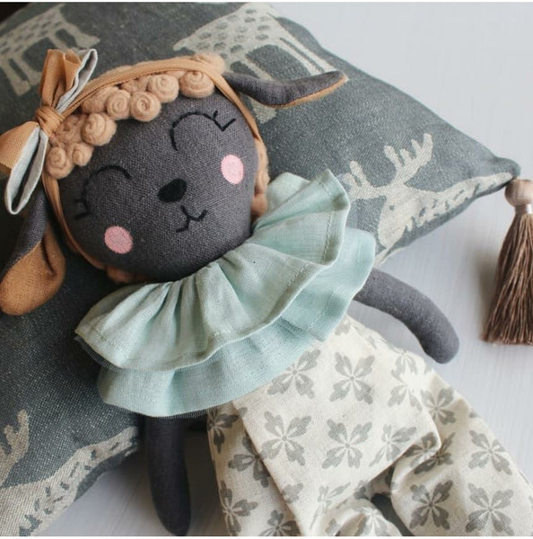 "US stockist of Vasya Vasya's heirloom quality, hand maded dark grey linen lamb with tan fleece curls on her head.  Wears beautiful patterned jumpsuit with a linen and tulle ruff around her neck.  Measures approximately 15"" in height."