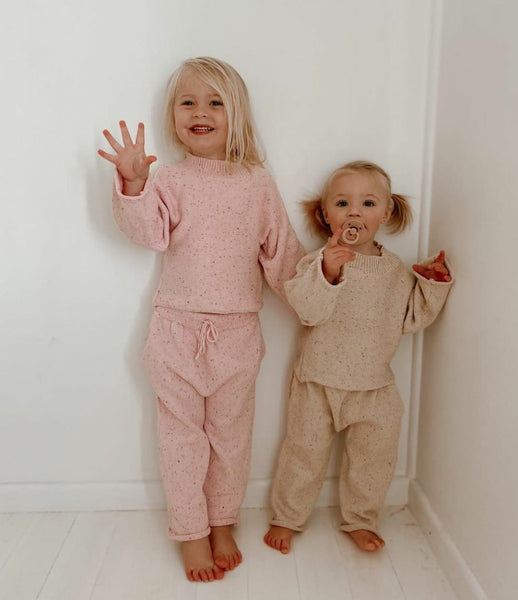 US stockist of Fable & Ford's Mini mid weight cotton knit pants.  In a gender neutral oat  color fabric with rainbow sprinkles.  Has a relaxed fit and features a functional drawstring and pockets.