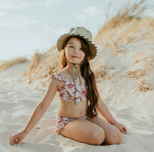 US stockist of Sukoo the Label's Harper Bikini in Dusty Floral.  Made from UPF 50 + Repreve fabric.  Crop top bikini top with ruffles at shoulder and high waisted bikini bottoms.