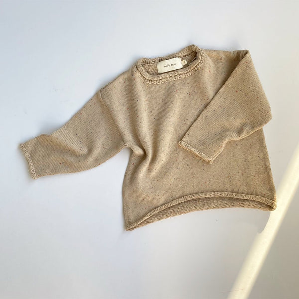 Beautiful, gender neutral slouchy knit sweater made from super soft, breathable cotton.  In a lovely speckle biscuit color, this sweater will pair perfectly with most outfits.  The most comfortable, cosiest sweater for those cooler nights.