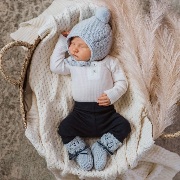 US stockist of Snuggle Hunny Kids blue merino wool bonnet and bootie set