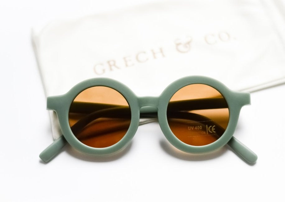 US stockist of Grech & Co's gender neutral sustainable sunglasses.  Made from recycled plastic, with round amber lens with UV 400 protection in a fern green color.