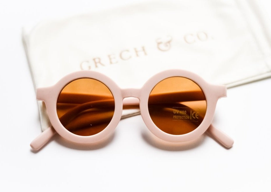 US stockist of Grech & Co's gender neutral sustainable sunglasses.  Made from recycled plastic, with round amber lens with UV 400 protection in a shell color.