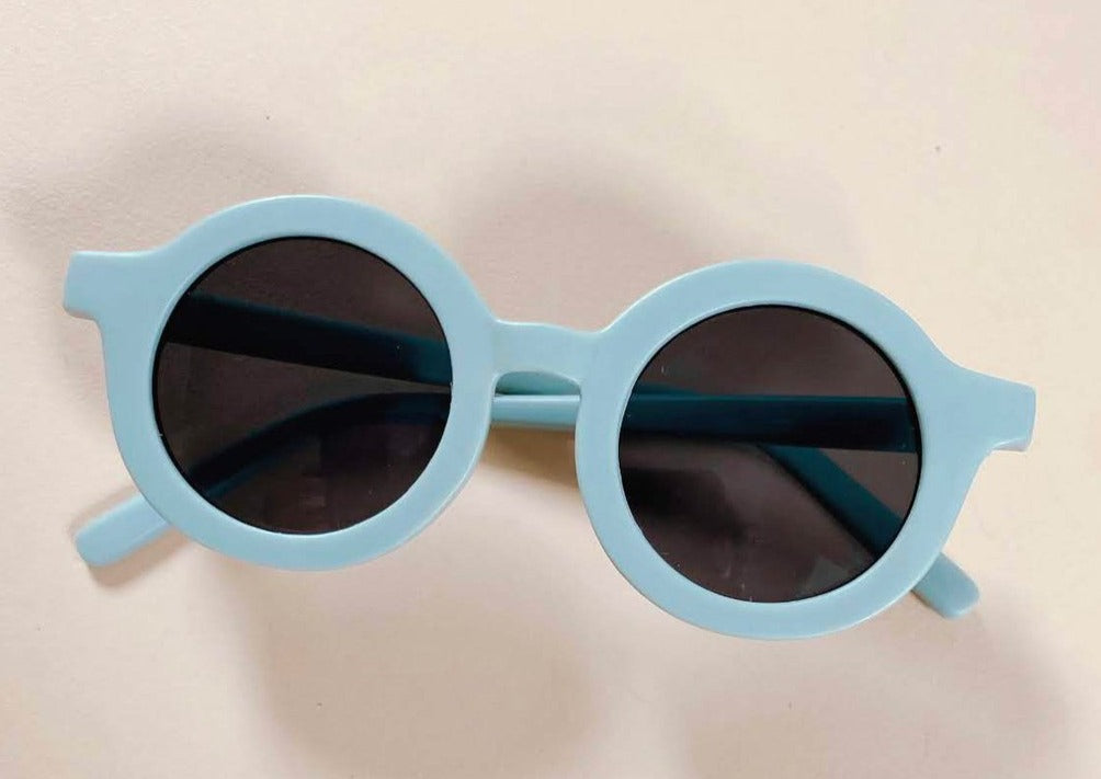 US stockist of Grech & Co's gender neutral sustainable sunglasses.  Made from recycled plastic, with round grey lens with UV 400 protection in a light blue color.