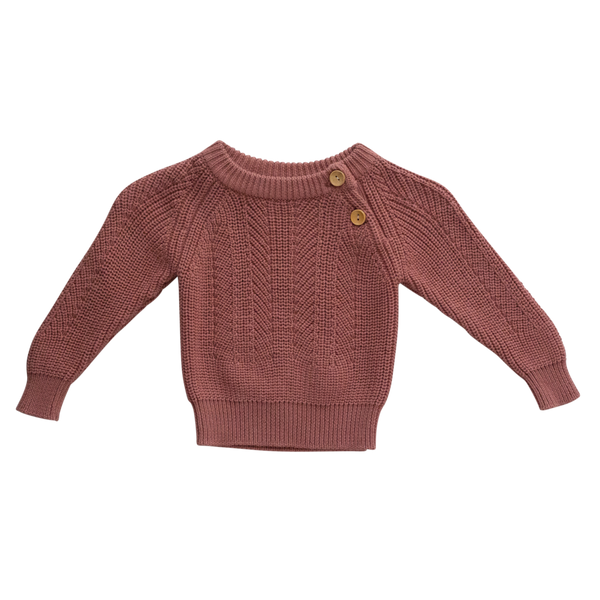 US stockist of Two Darlings gender neutral terracotta knit sweater.  Made from 100% cotton in a burnt blush color with two wood like buttons on the left shoulder.  Soft and stretchy.