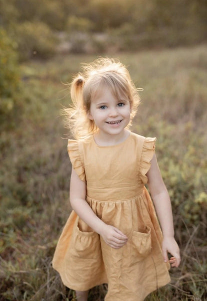 US stockist of Two Darlings Golden linen dress with flutter sleeves.