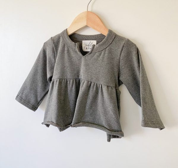 US stockist of Fable & Ford's V neck peplum top made from 100% soft ribbed cotton in slate grey.