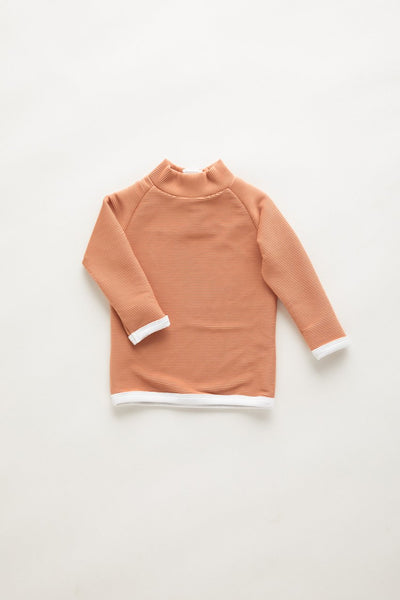 US stockist of Zulu & Zephyr Mini Band Rib Terracotta Gender Neutral L/Slv Rash Top