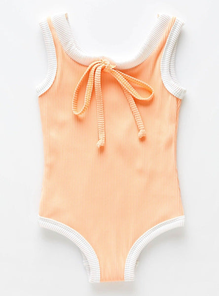 The Mini Band Onepiece in Grapefruit has a drawstring neck feature and contrast rib binds. Made from ECONYL sustainable ribbed fabric; fully lined and with a sun protection rating of 50+.