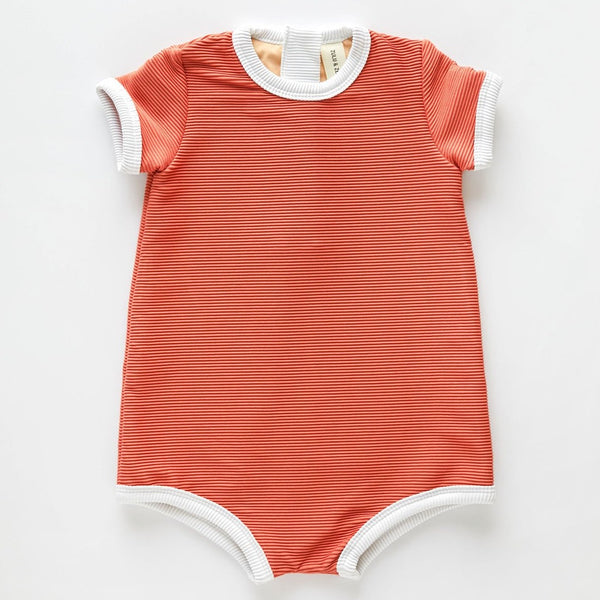 The US stockist of Zulu & Zephyr Mini Rib Onesie in Plum.  A loose fit gender neutral style made from sustainable ECONYL UPF 50+ fabric.  Short sleeved with contrasing back zipper and binds.  Fully lined.