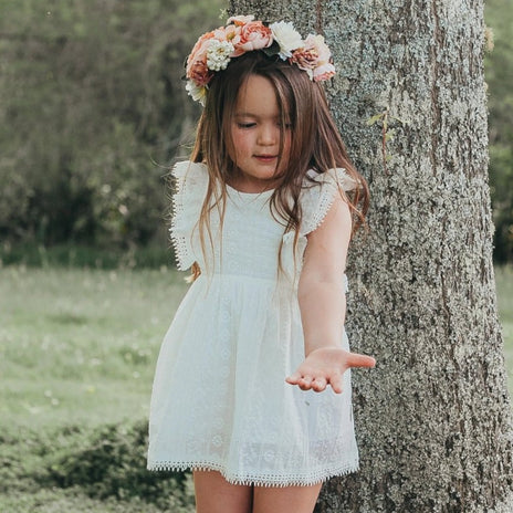 US stockist of Karibou Kids white Angel cotton and lace dress.  Beautifully detailed embroided cotton with lace trim on the ruffle sleeves and hem.  Invisible zip at side for easy dressing.