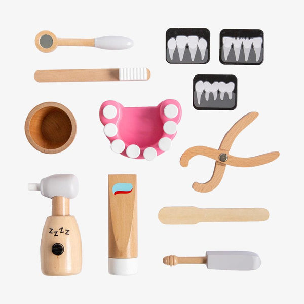US stockist of Make Me Iconic's 12 piece wooden pretend play dentist kit.  Contains a mouth model, x rays, toothpaster, drill and more.