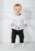 US stockist of Miann & Co's gender neutral charcoal baby knit pants. Made from 100% cotton with functional drawstring, pockets and ribbed cuffs.