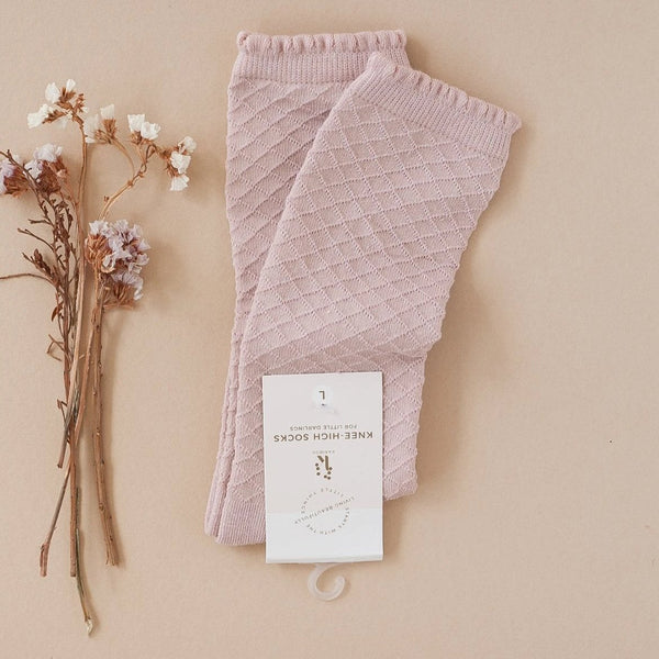 US stockist of Karibou Kids knee high cotton blend socks in rose blush.  Mesh texture with frill at the top.