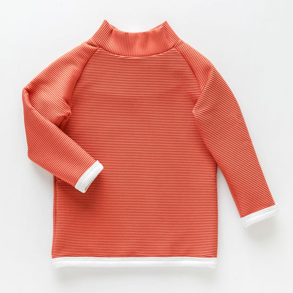 US stockist of Zulu & Zephyr's Mini Band long sleeve rashie top in gender neutral plum.  Made from ECONYL; fully lined and with a zip back entry.  Features contrasting rib binds and is UPF 50+