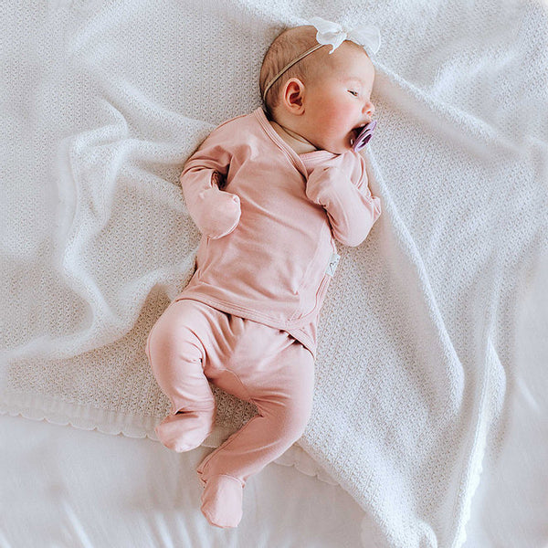 Stockist of Bonsie's rayon blend Peony pink footie.  Top section has velcro wrap body which can be undone for skin to skin contact.  Elastic waist that can be pulled down for easy diaper changes.