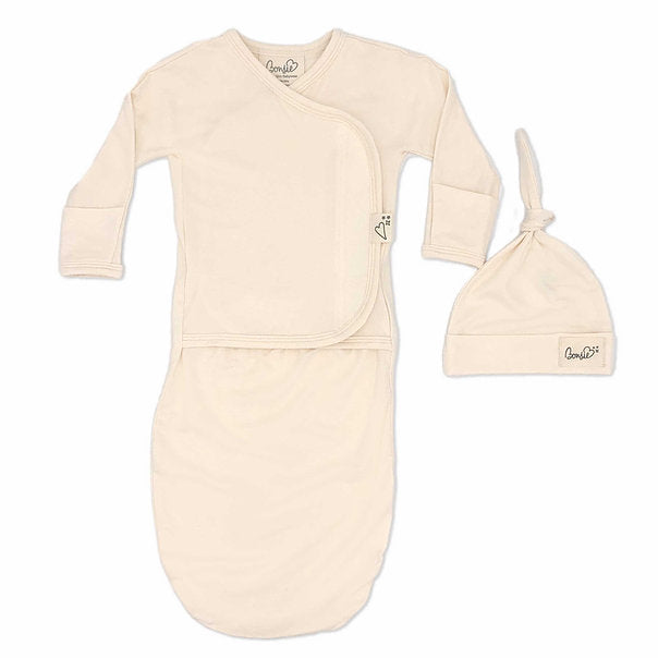 Stockist of Bonsie's rayon blend baby gown in gender neutral Oat.  Features cross over velcro top that can be undone for skin to skin.  Elastic waist which can be pulled down for easy diaper changes.
