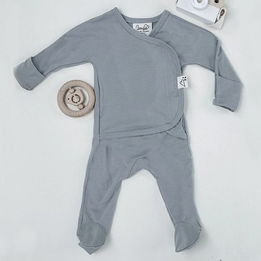 Stockist of Bonsie's rayon blend fog grey footie.  Top section has velcro wrap body which can be undone for skin to skin contact.  Elastic waist that can be pulled down for easy diaper changes.