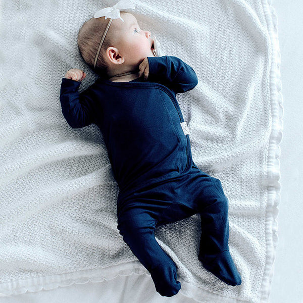 Stockist of Bonsie's rayon blend midnight blue footie.  Top section has velcro wrap body which can be undone for skin to skin contact.  Elastic waist that can be pulled down for easy diaper changes.