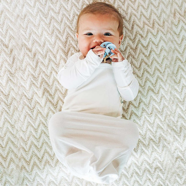 Stockist of Bonsie's rayon blend baby gown in gender neutral milk.  Features cross over velcro top that can be undone for skin to skin.  Elastic waist which can be pulled down for easy diaper changes.