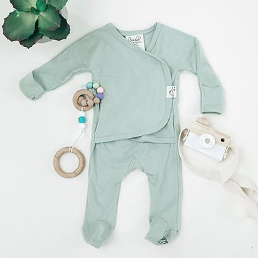 Stockist of Bonsie's rayon blend avocado green footie.  Top section has velcro wrap body which can be undone for skin to skin contact.  Elastic waist that can be pulled down for easy diaper changes.