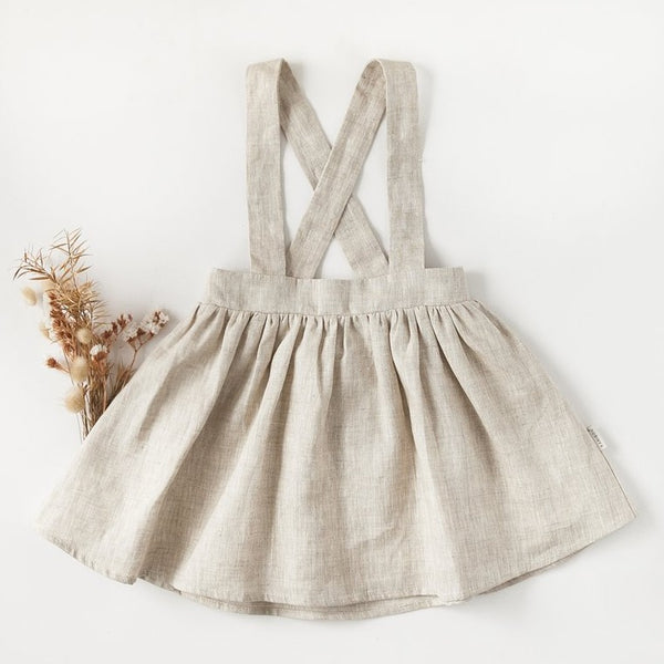 US stockist of Karibou Kid's Coco Suspender Skirt in Natural Linen.