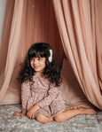 US stockist of Karibou Kid's Long Sleeve Cotton Puff pocket dress in dusty rose. Featues two front pockets and ties at back of neck.