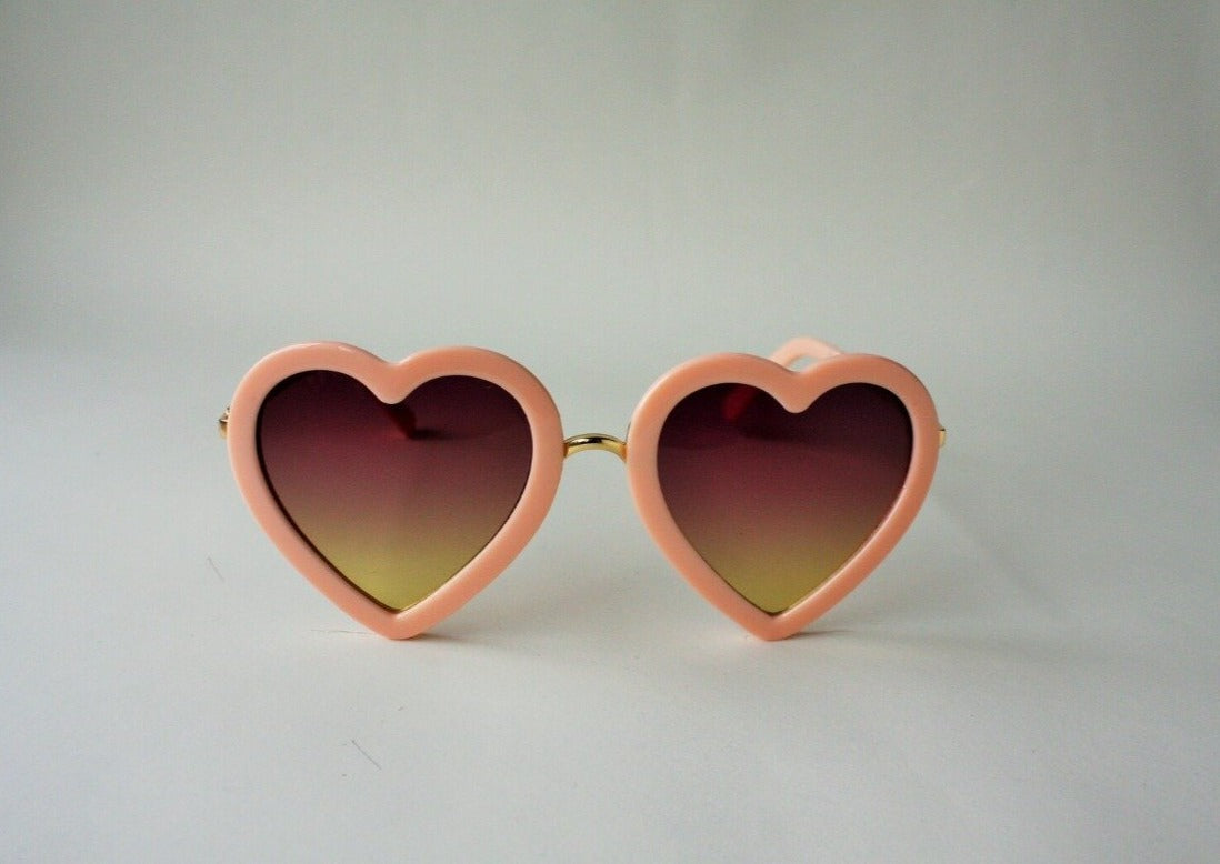 US stockist of Elle Porte's Heart shaped sunglasses in peach.
