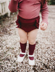 US stockist of Karibou Kids plum Georgia ribbed ruffle bloomers