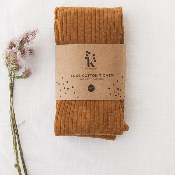 US stockist of Karibou Kid's gender neutral ribbed cotton tights in acorn; a beautiful golden color.