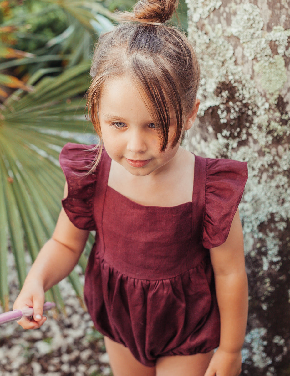 US stockist of Karibou Kids plum Karolina linen ruffle playsuit