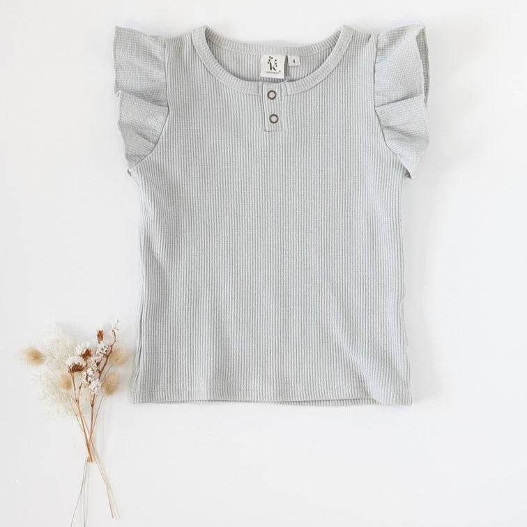 US stockist of Karibou Kids Keira Flutter Sleeve Waffle top in sky; a dusty light blue.  Made from a soft cotton and spandex blend.