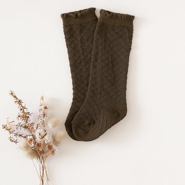 US stockist of Karibou Kid's Midnight Olive cotton socks. Warm dark olive color with mesh texture and frill at top. Cotton blend.