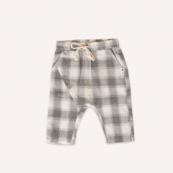 US stockist of My Brother John's Jed Pantaloon pants. Made from grey gingham cotton with a drop crotch, decorative buttons at front, cropped leg, pockets and functional drawstring at waist.